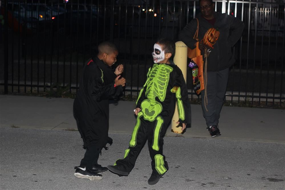 Kids dressed up in Halloween costumes for Trunk-or-Treat