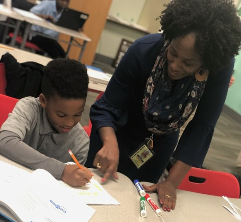PLA@103 Teacher Ms. Hill working with scholar