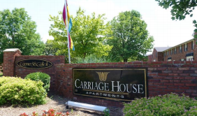 carriage house apartment sign