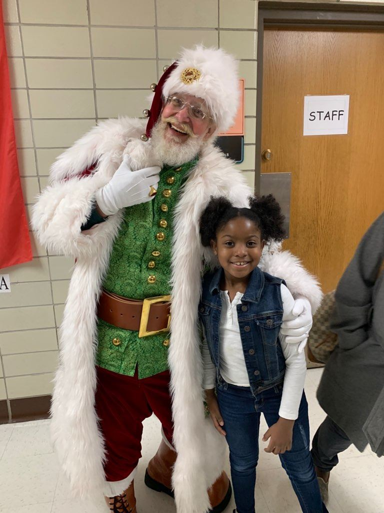 Timothy L. Johnson Scholar with Santa