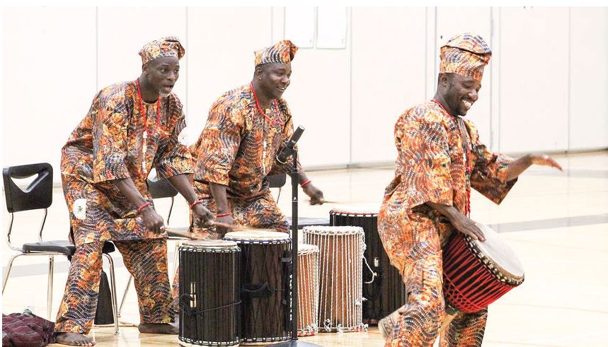 Bi-Okoto performers making music on stage