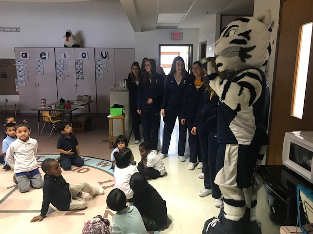 Trine University Cheerleads and Mascot visit Timothy L. Johnson Leadership Academy