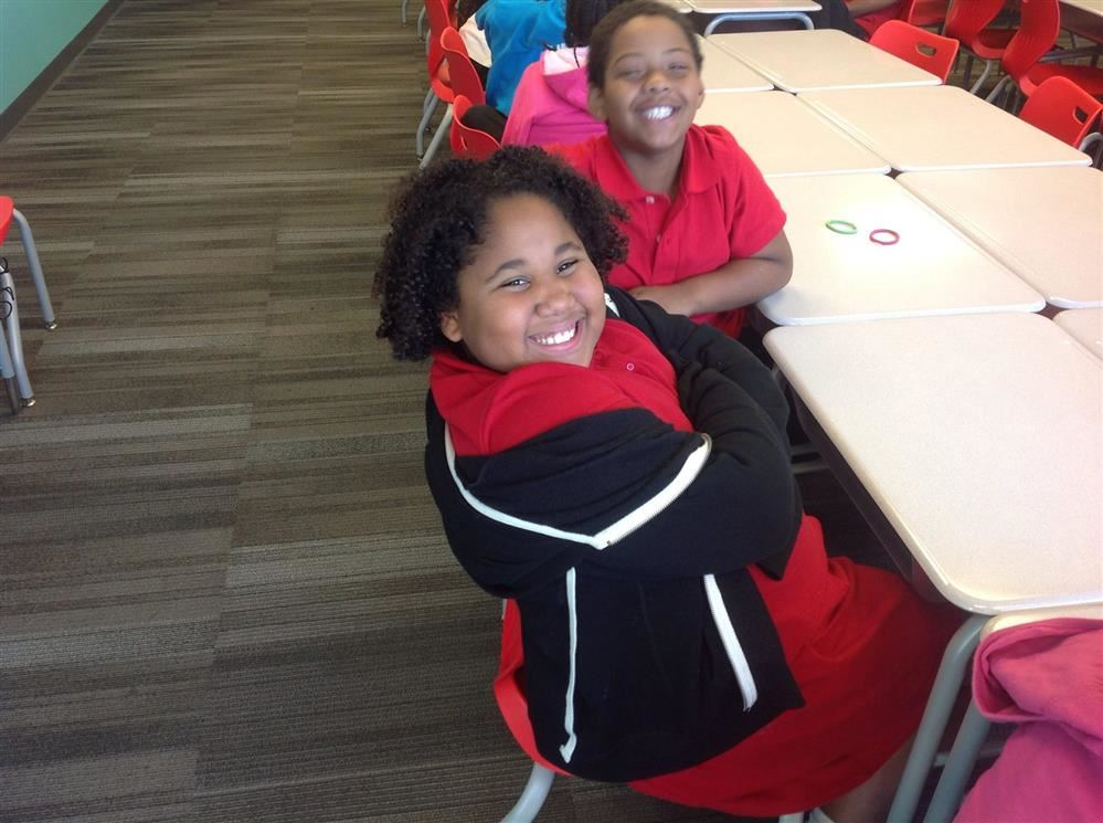 Students smiling in class.