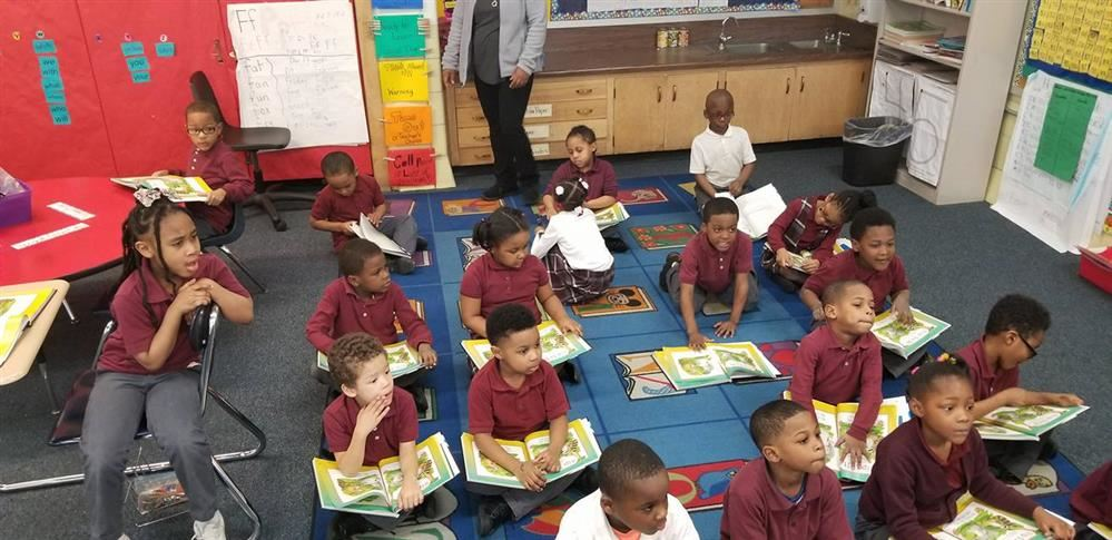 Thea Bowman Leadership Academy schols reading in the classroom