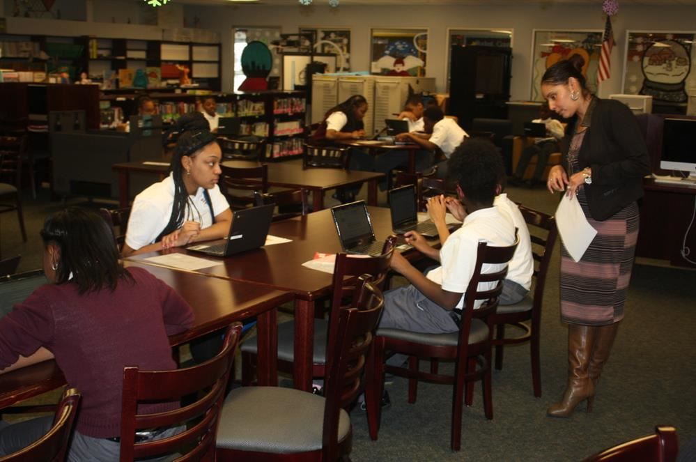 Thea Bowman Leadership Academy scholars working on their computers in the library