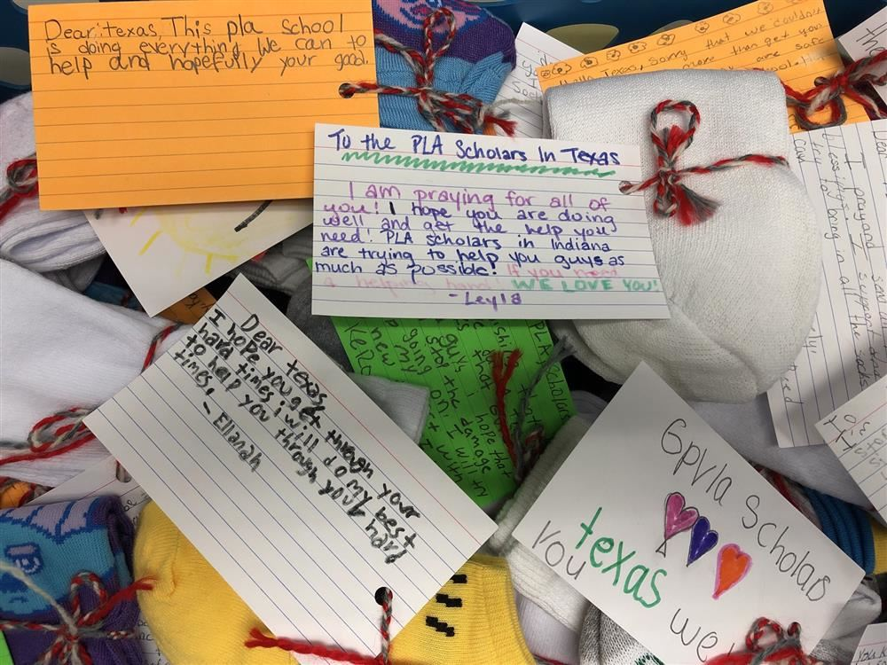 GVP scholars write notes of encouragement to Texas scholars impacted by Tropical Storm Imelda.