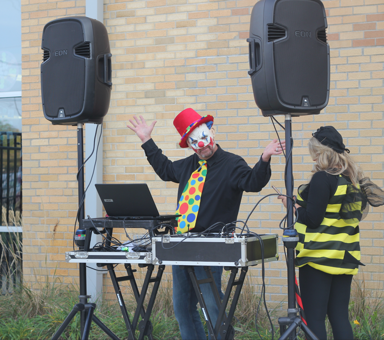 Clown running a DJ booth at Trunk-or-Treat event